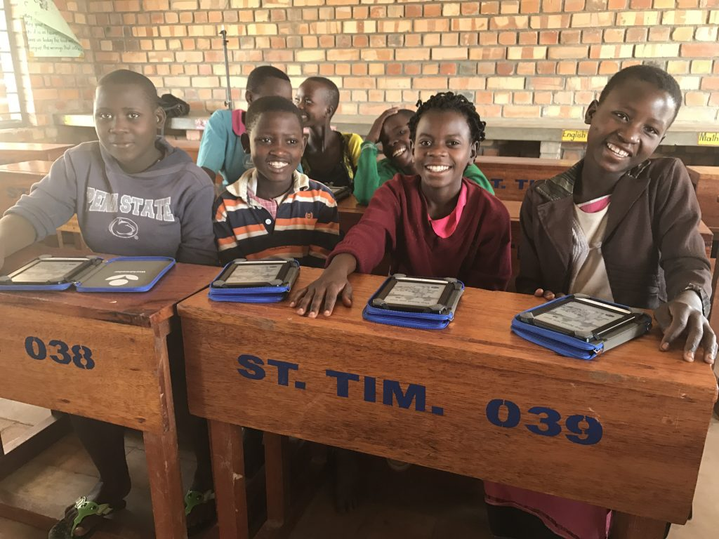 Group of children with ebooks